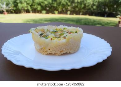 Traditional and authentic halwai style Indian sweet dish called Ghevar or ghewar, Indian dessert prepared and eaten during festivals like holi, diwali, rakshabandhan and teej. Tatsy rajasthani sweet