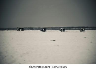 Traditional auto vehicles running around a coastal area
