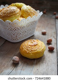 Traditional Azerbaijan cookies shor qogal on the rustic background with hazelnuts,space for text