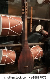Traditional azerbaijan and turkish music instruments - darbuka, nagara and saz at the souvenir shop in Sheki, Azerbaijan