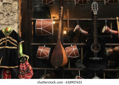 Traditional azerbaijan and turkish music instruments - darbuka, nagara and saz at the souvenir shop in Sheki, Azerbaijan