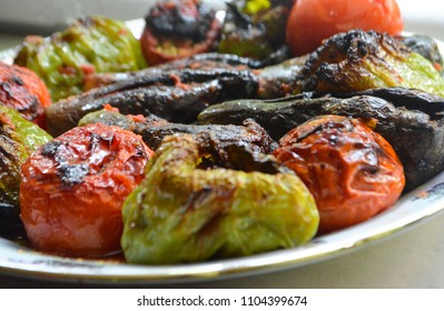 Traditional Azerbaijani dish three sisters dolma, also called eggplant dolma: fried green bell pepper, tomato and eggplant stuffed with mince ground meat and greens
