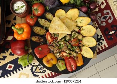 "Traditional Azerbaijani meal ""Saj"", a kind of dish prepared with lamb, tomato, potato, eggplant, bell pepper and mushroom all prepared together inside iron pan"