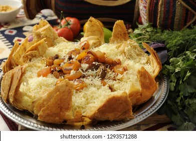 """Traditional Azerbaijani meal """"Shah Plov"""", a kind of plov prepared with rice, dry fruits like apricot, raisin, lamb meat all inside the lavash"""