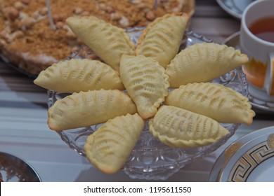 Traditional Azerbaijani sweet shekerbura shakarbura sybmol of Novruz holiday . Novruz tray with traditional Azerbaijan pastries shekerbura . Shekerbura baked during the spring holiday .