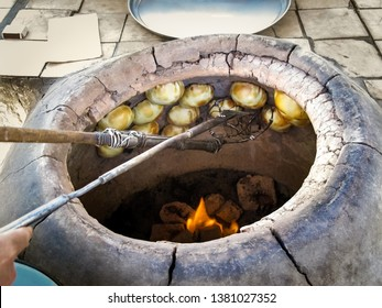Traditional baking tandoor dread in clay oven of Central Asia.