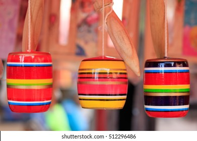 Traditional balero or cup-and-ball. Shallow depth of field.