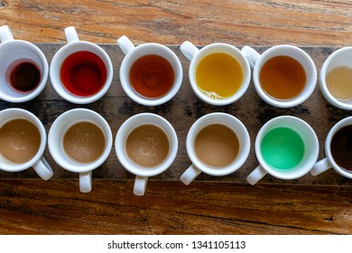Traditional Balinese coffee and tea after testing on the wooden table in Ubud, island Bali, Indonesia , close up