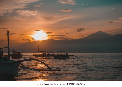 Traditional balinese fisherman's boats on sunrise in the ocean, Lovina, north of Bali, Indonesia
