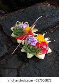 Traditional Balinese flower offerings to the Hindu God with incense.