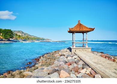 Traditional Balinese gazebo with ocean view. Candidasa, East Bali