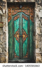 Traditional balinese handmade carved wooden door. Bali style furniture with ornament details