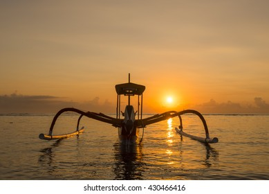 Traditional balinese jukung fishing boats on Sanur beach during sunrise. Bali, Indonesia, Asian