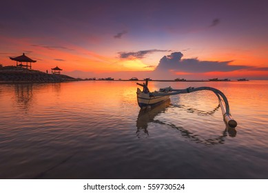 Traditional balinese jukung fishing boats on Sanur beach during beautiful sunrise at Bali, Indonesia, Asean