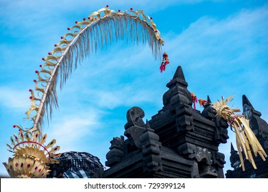 Traditional balinese penjor in Uluwatu temple of Bali, Indonesia. Tall bamboo poles with decoration are set on Bali in honour of hindu gods on religious festivals like Galungal, Kuningan.