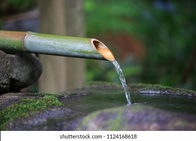 Traditional bamboo fountain at Japanese temple for washing before entrance