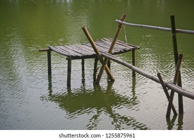 Traditional bamboo structure around a lake unique photo