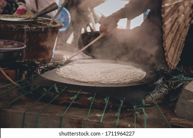 Traditional Banh Trang or rice paper making in Nhon Hoa rice paper village of Vietnam that is both a livelihood and cultural tourist attraction