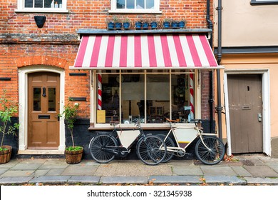 A traditional barber shop with bicycles outside