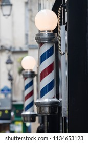 Traditional barber's poles in the Marais district of Paris, France