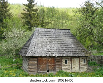 Traditional barn located in a rural village in northern Romania in Eastern Europe. It is built of timbers with corner notching and wood shingle roof.