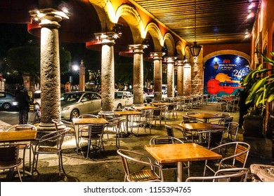 Traditional bar-terrace in a bar in Morelia at the evening. Morelia, June 2015.