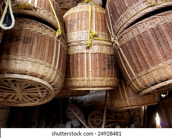 Traditional baskets hanging in house of village.