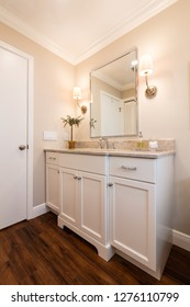 Traditional bathroom cabinet with a granite countertop.
