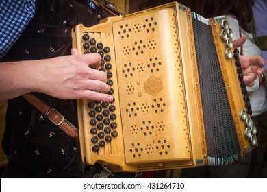 Traditional Bavarian accordion player playing folk music in Austria
