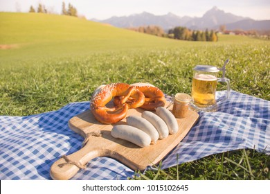 Traditional Bavarian food with weisswurst, sweet mustard, bretzel and beer. White sausages from Germany, Bavaria