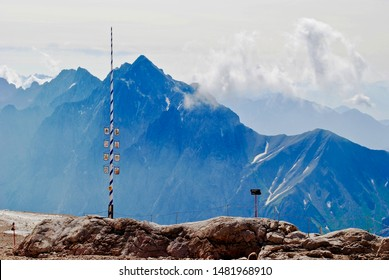 A traditional Bavarian May Pole stands on Germany's tallest mountain - Zugspitze. This is called the world's highest maypole and is used to celebrate spring each year.