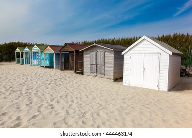 Traditional beach huts on fine golden sand at West Wittering Beach West Sussex England UK Europe