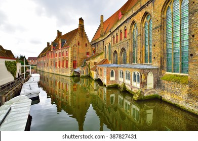 Traditional and beautiful architecture reflected in the canal, in Brugge, Belgium
