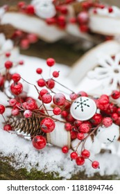 traditional beautiful Christmas wreath decoration for the new year for the holiday. Red berries and bells. All against the background of snow.