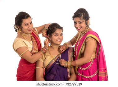 Traditional Beautiful Indian young girls in saree posing on white background