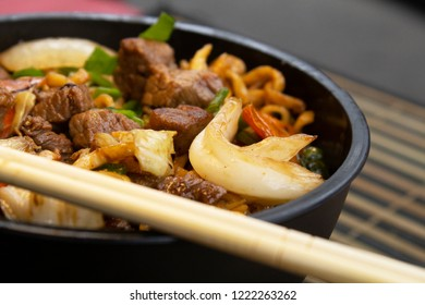 Traditional beef yakisoba. Japanese and Chinese Pasta