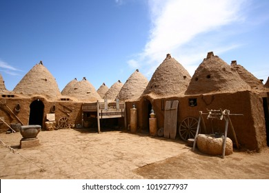 Traditional beehive mud brick desert houses,located in Harran, Urfa- Turkey. Traditional mud brick buildings topped with domed roofs and constructed from mud and salvaged brick.