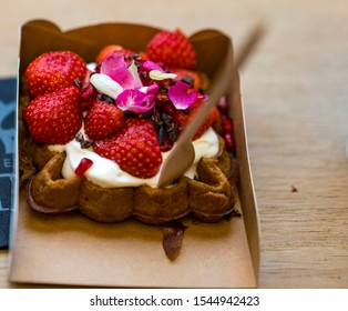 Traditional Belgian dessert - waffle with strawberry and cream. Brugge, Belgium.