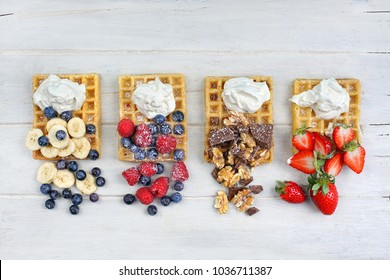 Traditional belgian waffles with fresh fruit and whipped cream