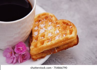 Traditional Belgian Waffles Heart with Cup of Coffee and Pink Flowers