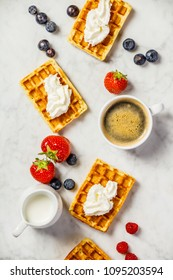 Traditional belgian waffles with whipped cream and fresh fruits