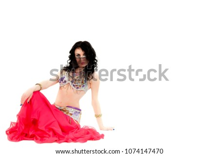 2ece990fc Traditional belly dance performed by young attractive natural beauty woman  dressed in colorful wear with long