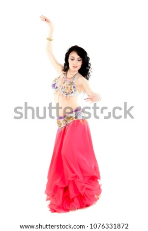 438600335 Traditional belly dance. Performed by young attractive natural beauty woman  with long curved dark hair