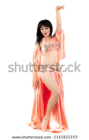 e9a06851d Traditional belly dance performed by young attractive natural beauty woman  dressed in colorful wear with straight