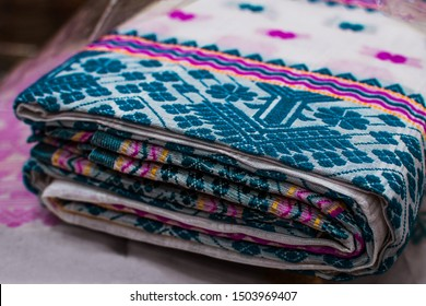 Traditional Bengali saree with weaving patterns. Indian fashion, textile industry