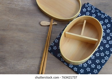 a traditional bento box made from bamboo