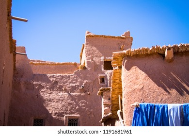 Traditional Berber blue scarf against the background of a brick wall for sale to tourists. Africa Morocco Ait Ben Haddou