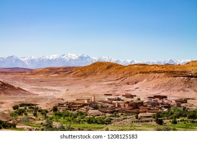 Traditional Berber city against the snowy Atlas Mountains. Africa Morocco Ait Ben Haddou