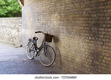 A Traditional Bicycle Rests on a Brick Wall