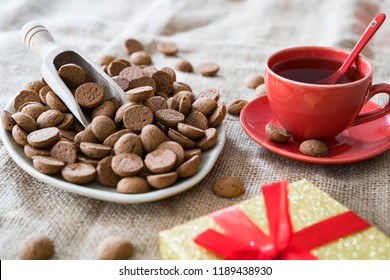 traditional biscuits called kruidnoten, with present and tea, for Dutch event Sinterklaas